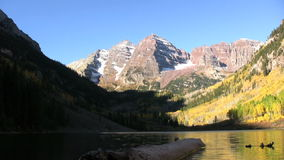 Maroon Bells in Autumn Reflection. Maroon bells and fall aspens reflected in maroon lake near aspen colorado stock footage