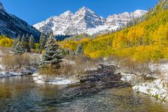 Maroon Bells and Creek in Autumn Snow Stock Photography