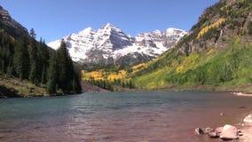 Maroon Bells in Early Fall. An early snow coats scenic maroon bells near aspen colorado in fall stock video footage