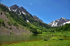 The Maroon Bells in the Elk Mountains. Maroon Lake occupies a basin that was sculpted by Ice-Age glaciers and later dammed by landslide and rockfall debris from Royalty Free Stock Image