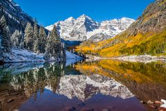 Maroon Bells in fall foliage after snow storm in Aspen, Colorad Royalty Free Stock Images