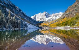 Maroon Bells in fall foliage after snow storm in Aspen, Colorado.  stock photo