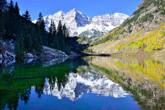 Maroon Bells during foliage season with snow covered mountains and yellow aspen reflecting in the lake Royalty Free Stock Photography