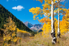 Maroon Bells framed by autumn aspens Stock Photo