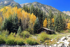 Maroon Bells and log cabin Stock Photography