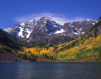 Maroon Bells & Maroon Lake. The twin peaks of the Maroon Bells and Maroon Lake, located in the White River National Forest of Colorado, photographed during the royalty free stock image