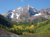 Maroon Bells, mountain, lake, Aspen, Co. Maroon Bells mountains in the early fall aspen trees changing color Royalty Free Stock Photos