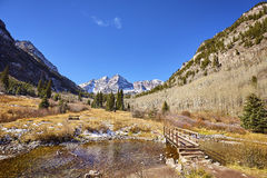 Maroon Bells mountain landscape with wooden bridge. Royalty Free Stock Images