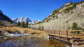 Maroon Bells mountain landscape with wooden bridge. Stock Photos