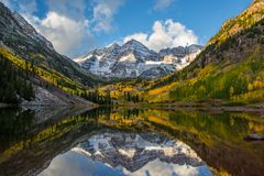 Morning Light Reflection at Maroon Bells in Colorado. Maroon Bells reflecting in the lake during early morning light in autumn Royalty Free Stock Photo