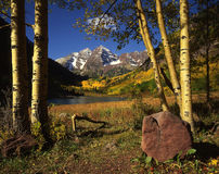 Maroon Bells & Rock. Mountain peaks with a lake, meadow, rock and forest in the foreground Royalty Free Stock Image