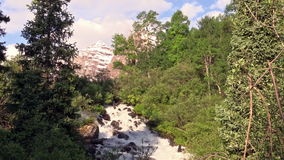 Maroon Bells Scenic. The snow capped maroon bells aspen colorado in early summer with a waterfall in the foreground stock video