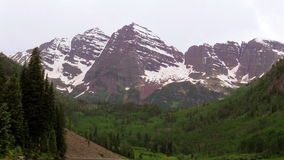 Maroon Bells Scenic in Summer. The snow capped maroon bells aspen colorado in early summer stock video