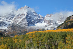 Maroon Bells, September aspens. Maroon Bells, Aspen, Colorado, at the end of September; aspens transitioning from green to gold Stock Photo