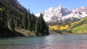 Maroon Bells Splendor. An early snow coats scenic maroon bells near aspen colorado in fall stock footage