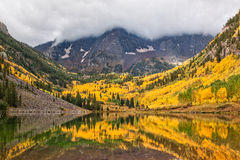 Maroon Bells Stormy Autumn Reflection Stock Photo