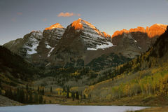 Maroon Bells in Sunrise. With aspen trees in Fall color, near Aspen, Colorado stock image