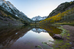 Maroon Bells Sunrise Aspen Colorado. Maroon Bells and its Reflection in the Lake with Fall foliage in Peak at Aspen, Colorado