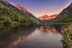 Maroon Bells Sunrise, Aspen, Colorado, USA. Maroon Bells lake wiith reflection glows up with sunrise, near Aspen, Colorado, USA royalty free stock photography