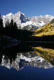 Maroon Bells Vertical. Maroonbells reflection in early morning Stock Photos