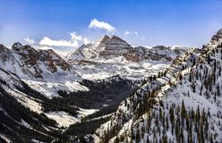 Maroon bells with snow tops. Maroon bells in a winter morning Stock Image