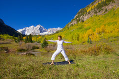 Maroon Bells  Yoga. A woman practicing yoga in the scenic colorado mountains in fall Royalty Free Stock Photo