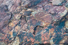 Maroon and black granite stone background Stock Photography