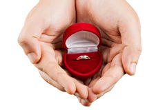 Maroon box with a wedding ring Stock Images