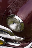 Maroon Classic Car. A close up abstract image of a maroon classic car, maroon color Stock Image
