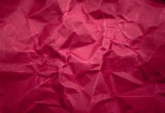 Maroon color crumpled paper texture background.  royalty free stock image