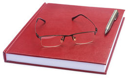 Maroon colored thesis paper Stock Image
