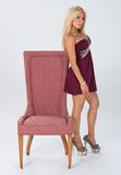 Maroon dress with trim themed shoot. Stock Image
