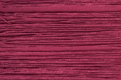 Maroon fabric with fringe. Close-up. Background.  royalty free stock photography