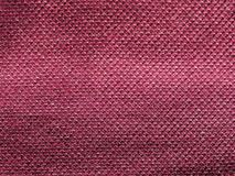 Maroon fabric texture background. Maroon fabric texture useful as a background Stock Images