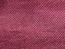 Maroon fabric texture background. Maroon fabric texture useful as a background Royalty Free Stock Images