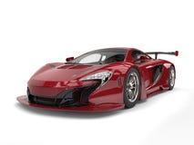 Maroon futuristic race car Stock Photos