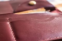 Maroon leather wallet pockets closeup - Image. Maroon leather wallet pockets, maroon leather wallet closeup - Image royalty free stock photos