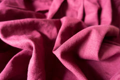 Maroon linen fabric with folds and shadows. Pale maroon linen fabric with folds and shadows Stock Photo