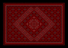 Maroon luxurious oriental carpet with colored ornament in the middle Royalty Free Stock Images