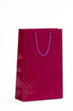 Maroon paper bag on a white background Royalty Free Stock Photos