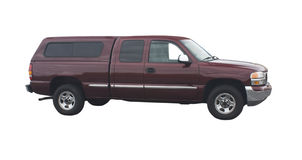 Maroon pickup truck. Maroon extended cab pickup truck with topper stock photography