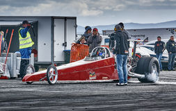 Maroon racing car during the race Royalty Free Stock Images