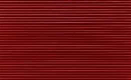 Maroon red horizontal roller shutter blinds. Background texture of dark maroon red or brown color painted horizontal metal window roller shutter blinds royalty free stock photos