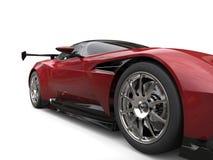 Maroon sports car - front wheel extreme closeup shot Stock Photo