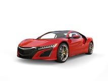 Maroon super sports car - studio shot Royalty Free Stock Photography