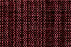 Maroon textile background with checkered pattern, closeup. Structure of the red fabric macro. Stock Photography