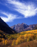 Maroon Valley. A vertical image of the twin mountain peaks called the maroon bells in Colorado during the autumn season royalty free stock image