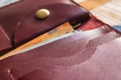Maroon wallet pockets closeup with euro banknotes inside. Image stock image