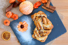 Marple and pecan plait pastry. Sweet food breakfast with flower Stock Photos