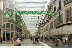 Marqués de Larios, Malaga. Malaga, Spain-August 26th 2015: People shopping in Marqués de Larios. The street is the main shopping street in the city Royalty Free Stock Photos